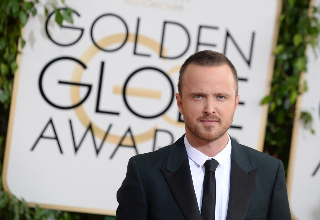 Description of . Aaron Paul arrives at the 71st annual Golden Globe Awards at the Beverly Hilton Hotel on Sunday, Jan. 12, 2014, in Beverly Hills, Calif. (Photo by Jordan Strauss/Invision/AP)