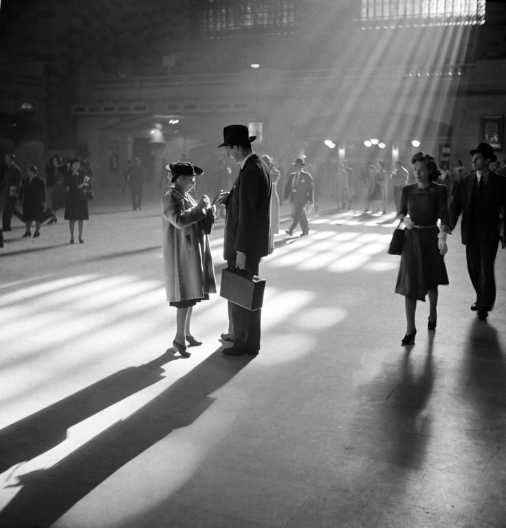 Description of . A man and woman talk together as people pass through the Main Concourse of New York's Grand Central Terminal -- commonly known as Grand Central Station -- in Midtown Manhattan, in October 1941. (AP Photo/Farm Security Administration, John Vachon)