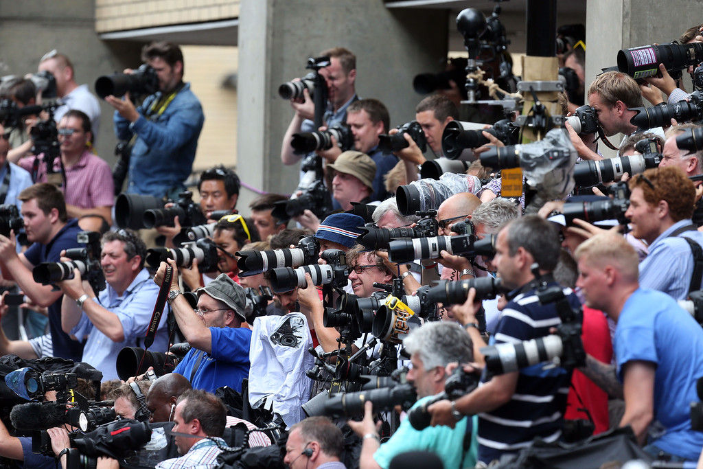 Description of . Photographers take pictures of The Duchess of Cambridge\'s parents Carole and Michael Middleton as they arrive at the Lindo Wing of St Mary\'s Hospital in London, to meet their new grandson Tuesday, July 23, 2013. Prince William, Kate and their baby boy were spending their first full day as a family Tuesday inside a London hospital, thanking staff for their care but making well-wishers wait for a first glimpse of the royal heir.  (AP Photo / Steve Parsons/PA)