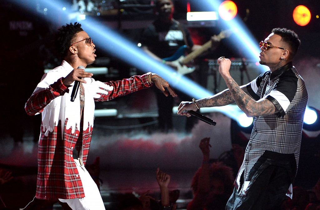Description of . Singers August Alsina (L) and Trey Songz perform onstage during the BET AWARDS '14 at Nokia Theatre L.A. LIVE on June 29, 2014 in Los Angeles, California.  (Photo by Kevin Winter/Getty Images for BET)