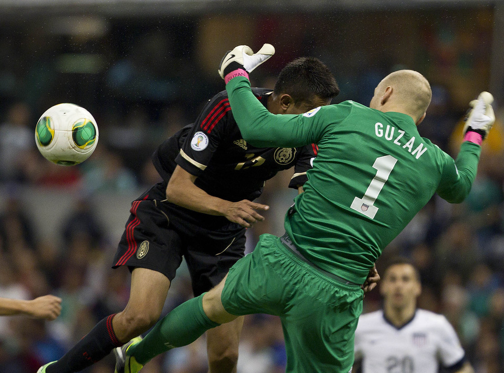 . Mexico\'s Jesus Zabala, left ,  tries a header as United States\' goalkeeper Brad Guzan blocks him during a World Cup 2014 qualifying match at the Aztec stadium in Mexico City, Tuesday, March 26, 2013. (AP Photo/Christian Palma)