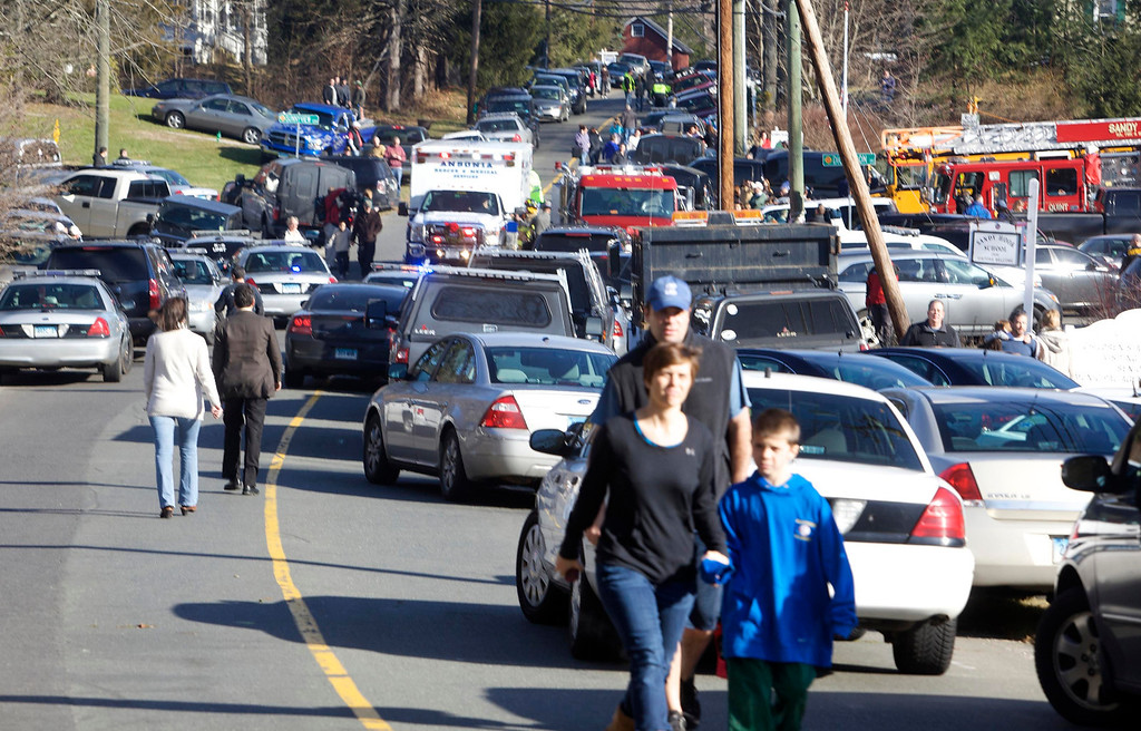 Description of . Parents pick-up their children near Sandy Hook Elementary School in Newtown, Connecticut, December 14, 2012. A shooter opened fire at the elementary school in Newtown, Connecticut, on Friday, killing several people including children, the Hartford Courant newspaper reported. REUTERS/Michelle McLoughlin