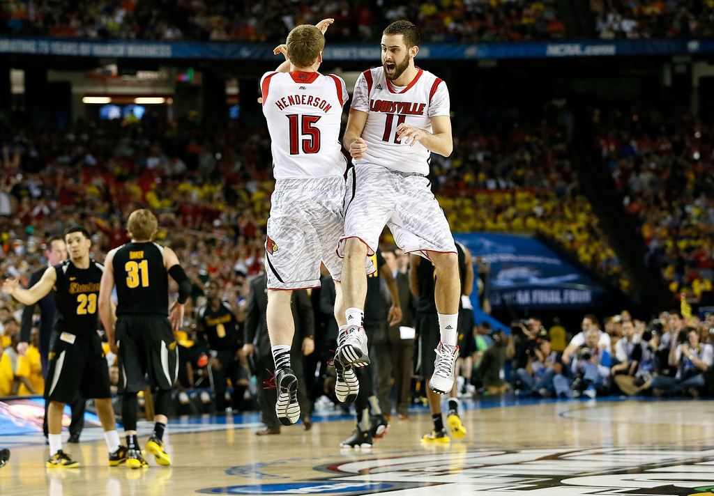 Description of . ATLANTA, GA - APRIL 06:  Tim Henderson #15 and Luke Hancock #11 of the Louisville Cardinals celebrate late in the second half while taking on the Wichita State Shockers during the 2013 NCAA Men's Final Four Semifinal at the Georgia Dome on April 6, 2013 in Atlanta, Georgia.  (Photo by Kevin C. Cox/Getty Images)