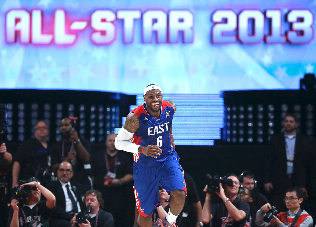 Description of . NBA All-Star LeBron James of the Miami Heat smiles as he runs back up the court during the 2013 NBA All-Star basketball game in Houston, Texas, February 17, 2013.  REUTERS/Lucy Nicholson