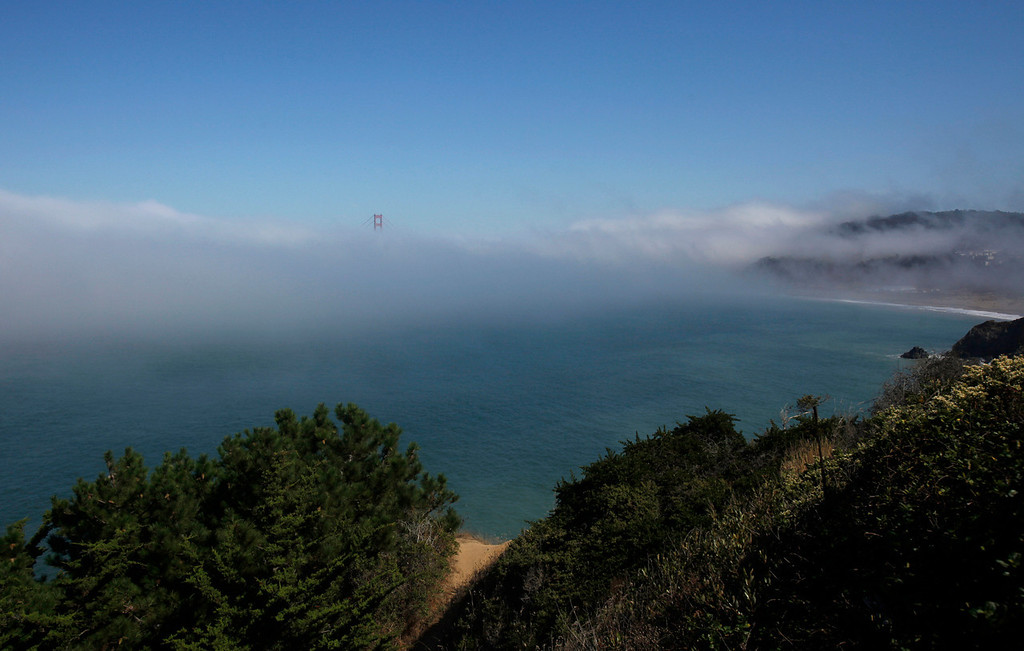 Description of . A span of the Golden Gate Bridge is seen through fog from Land's End in San Francisco, Wednesday, Sept. 29, 2010. (AP Photo/Jeff Chiu)