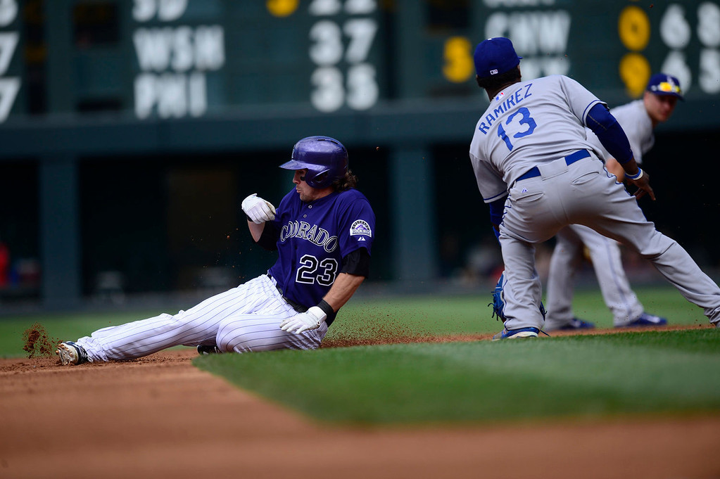 Description of . Hanley Ramirez (13) of the Los Angeles Dodgers receives a throw from Yasiel Puig (66) as Charlie Culberson (23) of the Colorado Rockies slides in safely with a double during the action in Denver on Monday, September 2, 2013. The Colorado Rockies hosted the Los Angeles Dodgers at Coors Field.   (Photo by AAron Ontiveroz/The Denver Post)