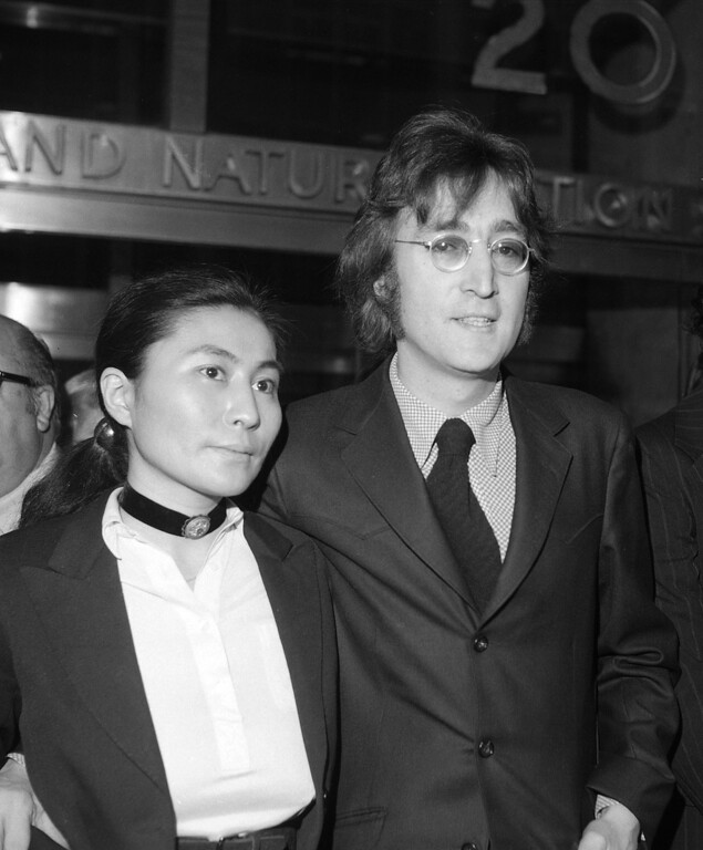 Description of . In this March 16, 1972 file photo, John Lennon and Yoko Ono leave a brief deportation hearing in New York at the offices of the Department of Immigration and Naturalization. Yoko Ono is planning a series of events in Iceland to mark what would have been John Lennon's 70th birthday. The artist and peace campaigner will light the Imagine Peace Tower illuminated memorial, located on the island of Vioey near Icelandic capital Reykjavik, on Oct. 9, 2010.  (AP Photo/Tony Camerano, File)