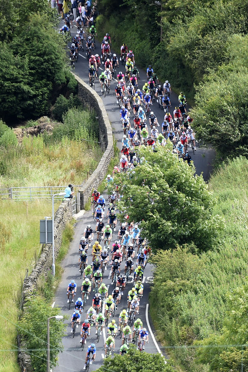 Description of . The pack rides during the 201 km second stage of the 101th edition of the Tour de France cycling race on July 6, 2014 between York and Sheffield, northern England.  AFP PHOTO / ERIC FEFERBERGERIC FEFERBERG/AFP/Getty Images