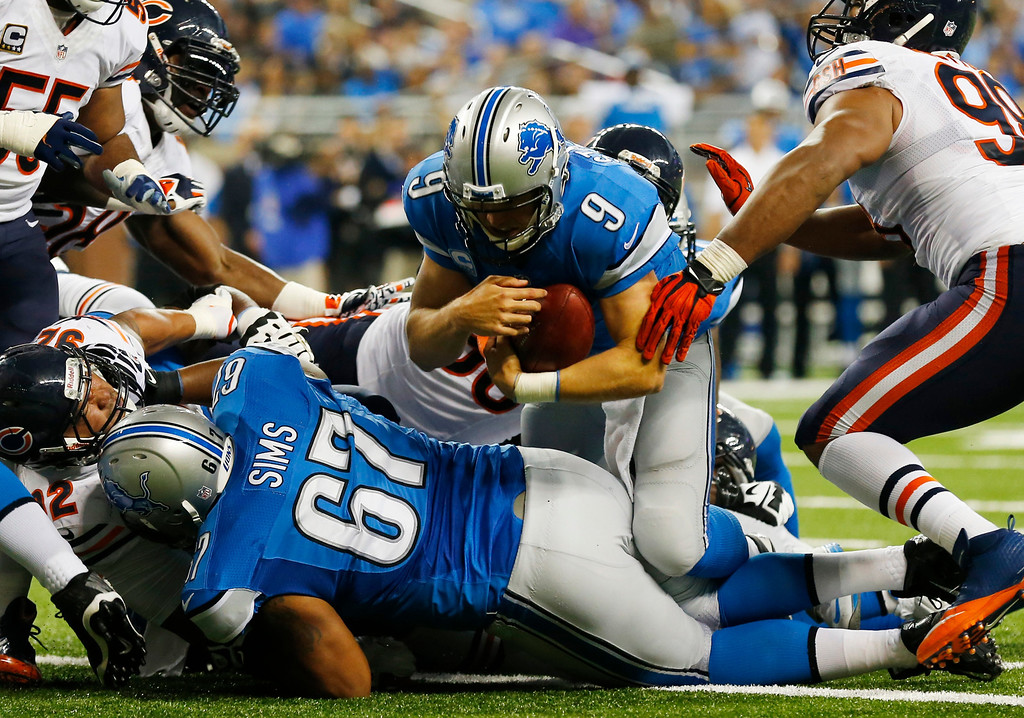 Description of . Detroit Lions quarterback Matthew Stafford (9) falls over the goal line for a touchdown after recovering his own fumble during the second quarter of an NFL football game against the Chicago Bears at Ford Field in Detroit, Sunday, Sept. 29, 2013. (AP Photo/Paul Sancya)