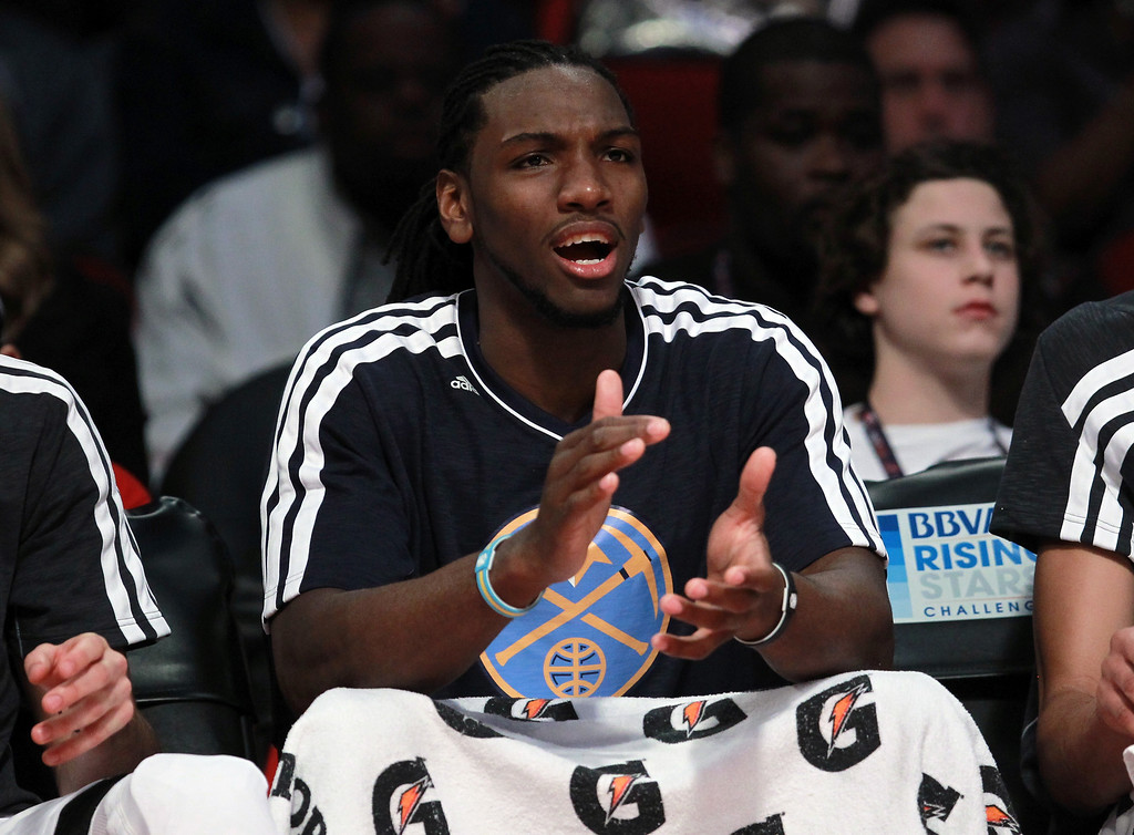 Description of . HOUSTON, TX - FEBRUARY 15:  Kenneth Faried #35 of the Denver Nuggets and Team Chuck reacts from the bench in the second half in the BBVA Rising Stars Challenge 2013 part of the 2013 NBA All-Star Weekend at the Toyota Center on February 15, 2013 in Houston, Texas.  (Photo by Ronald Martinez/Getty Images)