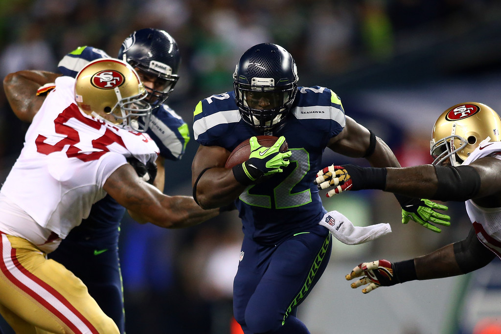 Description of . Robert Turbin #22 of the Seattle Seahawks runs the ball against Ahmad Brooks #55 of the San Francisco 49ers during their game at Qwest Field on September 15, 2013 in Seattle, Washington.  (Photo by Jonathan Ferrey/Getty Images)