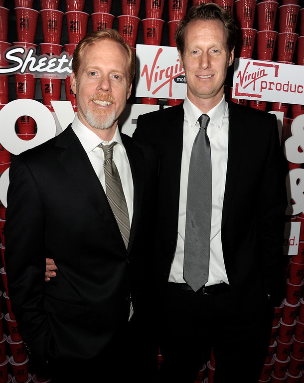 Description of . Writer/directors Scott Moore (L) and Jon Lucas arrive at the premiere of Relativity Media's