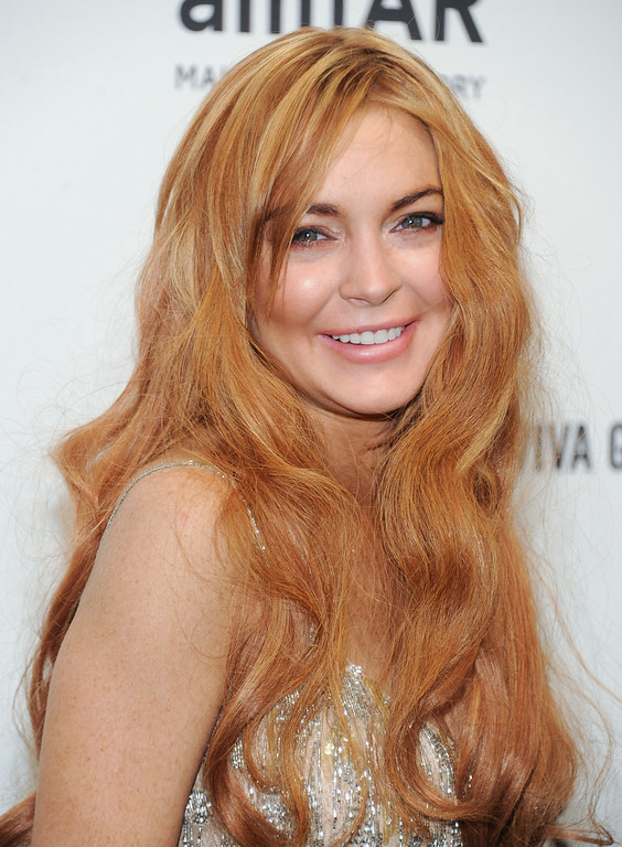 Description of . Actress Lindsay Lohan attends amfAR's New York gala at Cipriani Wall Street on Wednesday, Feb. 6, 2013 in New York. (Photo by Evan Agostini/Invision/AP)