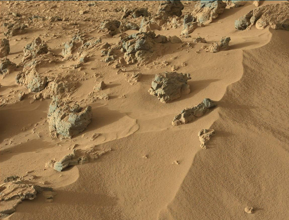 Description of . This October 30, 2012 image from the Mast Camera on NASA's Curiosity rover shows the upper portion of a wind-blown deposit dubbed