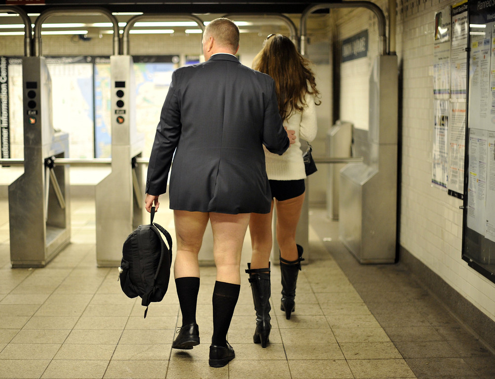 Description of . Some riders enter the New York subway in their underwear as they take part in the 2014 No Pants Subway Ride on January 12, 2014. Started by Improv Everywhere, the goal is for riders to get on the subway train dressed in normal winter clothes without pants and keep a straight face.    TIMOTHY A. CLARY/AFP/Getty Images