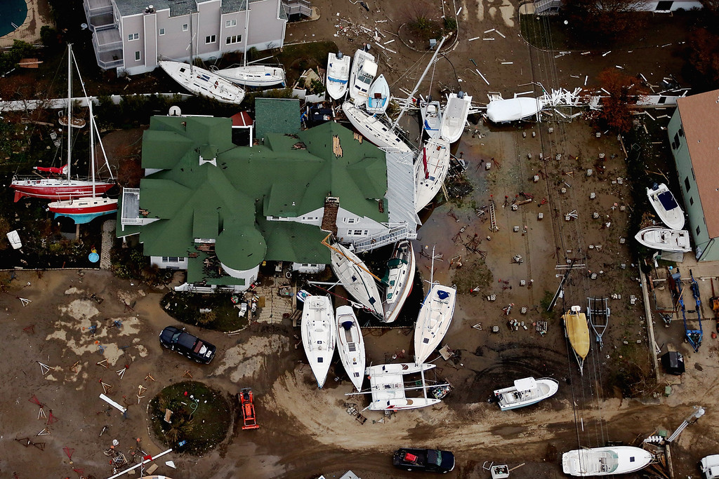Description of . Boats are strewn among buildings amid wreckage from Superstorm Sandy on October 31, 2012 in Sea Bright, New Jersey. At least 50 people were reportedly killed in the U.S. by Sandy with New Jersey suffering massive damage and power outages. (Photo by Mario Tama/Getty Images)