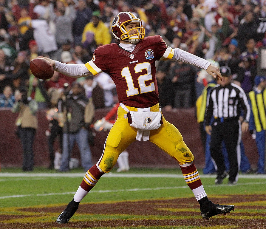 Description of . Washington Redskins quarterback Kirk Cousins spikes the ball after a two point conversion to tie the game and force overtime during the second half of an NFL football game against the Baltimore Ravens in Landover, Md., Sunday, Dec. 9, 2012. (AP Photo/Patrick Semansky)