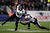Bernard Pierce #30 of the Baltimore Ravens runs the ball against Kyle Arrington #24 of the New England Patriots during the 2013 AFC Championship game at Gillette Stadium on January 20, 2013 in Foxboro, Massachusetts.  (Photo by Elsa/Getty Images)