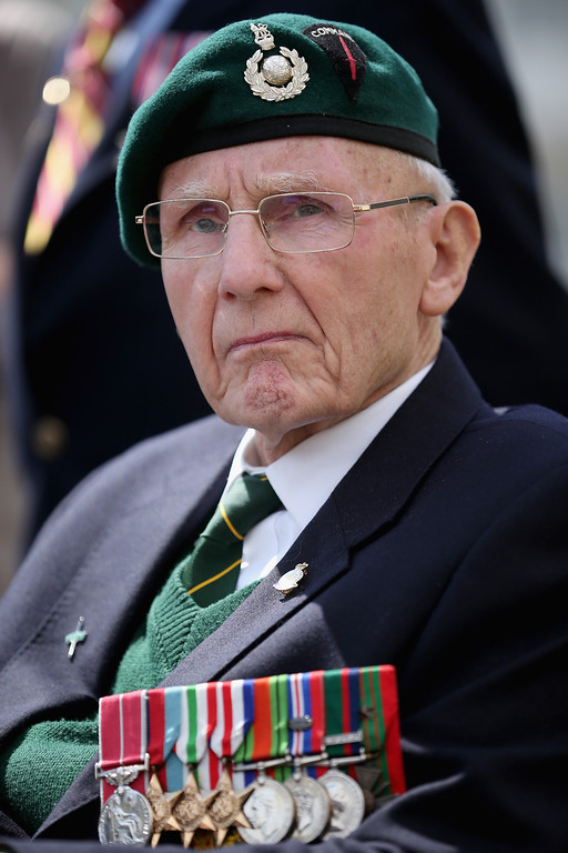 Description of . D-Day veteran and Royal Marine commando Jim Kelly, aged 91, looks on during the Royal Artillery Commemoration Parade and service on Sword Beach on June 5, 2014 in Hermanville, France.   (Photo by Christopher Furlong/Getty Images)