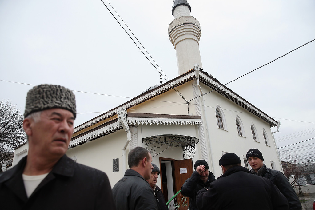 Description of . SIMFEROPOL, UKRAINE - MARCH 07:  Muslim men, mostly Crimean Tatars, arrive for Friday midday prayers at the Kebir-Dzhami Mosque, which is the city's oldest, on March 7, 2014 in Simferopol, Ukraine. Crimean Tatars, hundreds of thousands of whom Stalin deported in the 1950s, make up between 15%-20% of Crimea's population and have historically been suspicious of Russian rule. The pro-Russian Crimean Parliament voted yesterday to secede from Ukraine, join Russia and hold a referendum on the issue on March 16. The Crimean population is majority Russian, a large number of whom are enthusiastically supporting annexation to Russia.  (Photo by Sean Gallup/Getty Images)