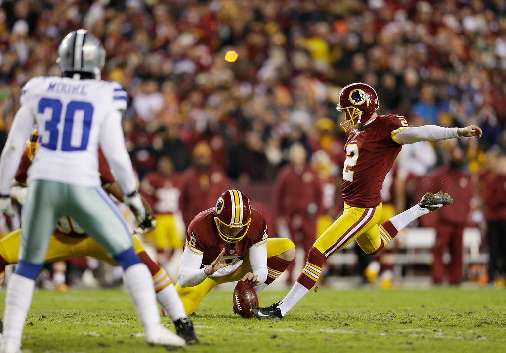 . LANDOVER, MD - DECEMBER 30:   Kicker Kai Forbath #2 of the Washington Redskins misses a field goal attempt against the Dallas Cowboys in the first quarter at FedExField on December 30, 2012 in Landover, Maryland.  (Photo by Rob Carr/Getty Images)