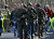 Heavily armed Connecticut State troopers are on the scene at the Sandy Hook School following a shooting at the school, Friday, Dec. 14, 2012 in Newtown, Conn. A man opened fire inside the Connecticut elementary school where his mother worked Friday, killing 26 people, including 18 children, and forcing students to cower in classrooms and then flee with the help of teachers and police. (AP Photo/The Journal News, Frank Becerra Jr.)