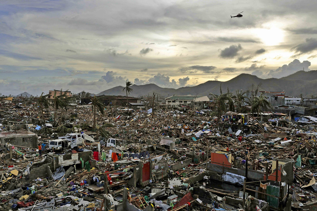 Description of . An entire neighbourhood is destroyed in the aftermath of Typhoon Haiyan on November 13, 2013 in Tacloban, Leyte, Philippines. Typhoon Haiyan, packing maximum sustained winds of 195 mph (315 kph), slammed into the southern Philippines and left a trail of destruction in multiple provinces, forcing hundreds of thousands to evacuate and making travel by air and land to hard-hit provinces difficult. Around 10,000 people are feared dead in the strongest typhoon to hit the Philippines this year. (Photo by Kevin Frayer/Getty Images)