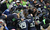 Seattle Seahawks fans swarm players after Malcolm Smith #53 scored a touchdown on a fumble recovery in the endzone against the Arizona Cardinals in the second quarter at CenturyLink Field on December 9, 2012 in Seattle, Washington.  (Photo by Kevin Casey/Getty Images)