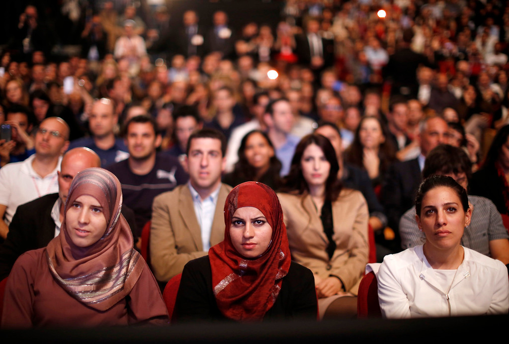 Description of . Members of the audience listen as U.S. President Barack Obama delivers a speech on Mideast policy at the Jerusalem Convention Center, March 21, 2013.   REUTERS/Jason Reed