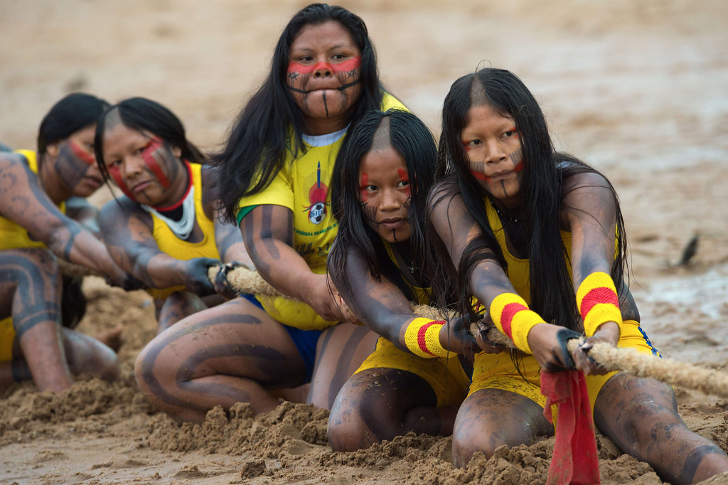 Description of . Brazilian indigenous women of the Kaiapo Durutiri tribe participate in a tug of war competition during the XII International Games of Indigenous Peoples in Cuiaba, Mato Grosso state, Brazil on November 12, 2013. AFP PHOTO / Christophe SIMON/AFP/Getty Images