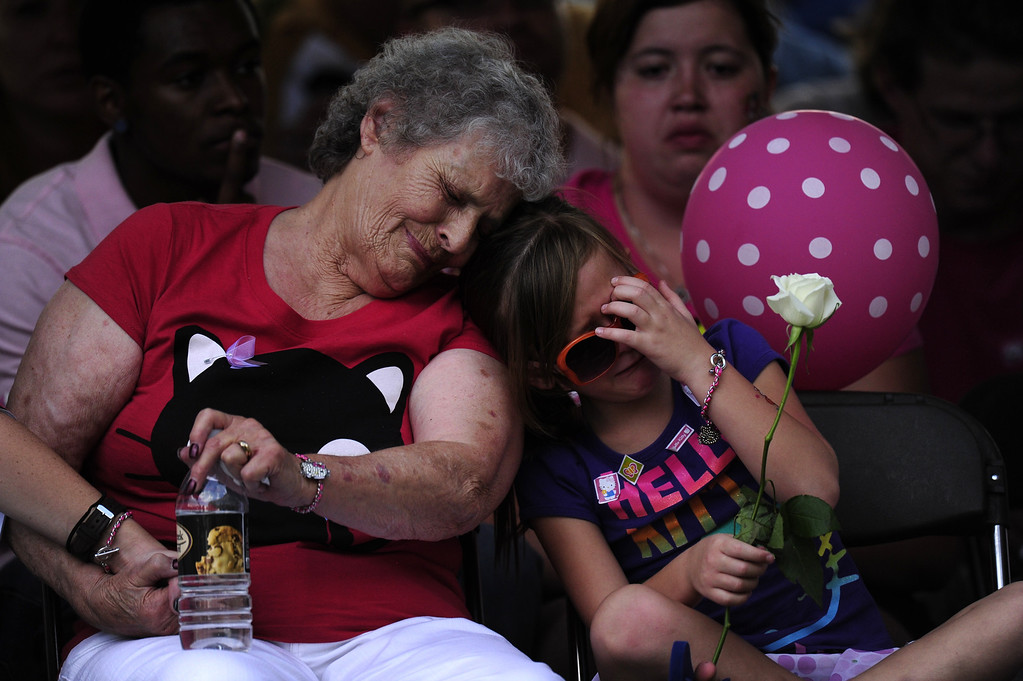 Description of . Marlene Knobbe, grandmother of Micayla Medek killed in the movie theater shooting, consoles family member Rachel Vigil at a community vigil at the Aurora Municipal Center on Sunday, July 22, 2012. AAron Ontiveroz, The Denver Post