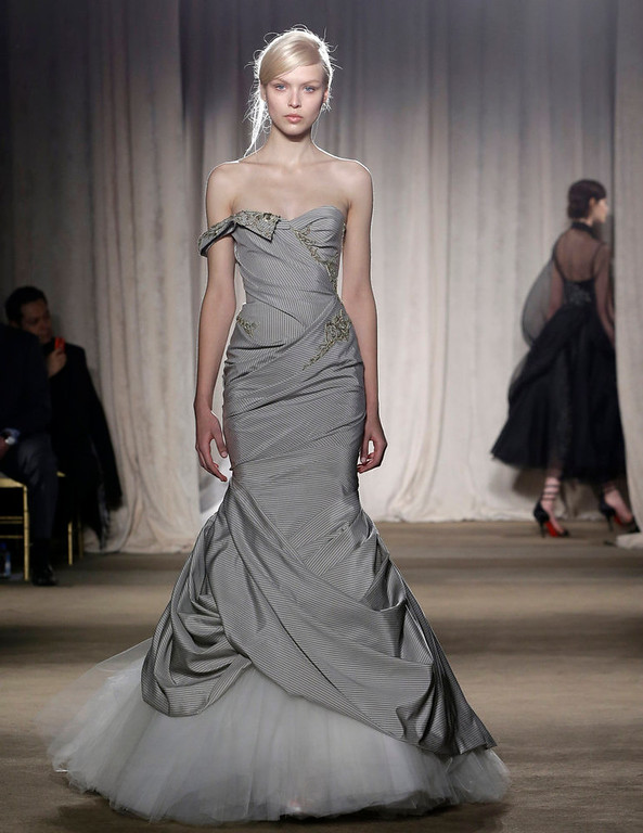 Description of . A model walks the runway during the Marchesa Fall 2013 fashion show at Fashion Week in New York, Wednesday, Feb. 13, 2013.  (AP Photo/Kathy Willens)