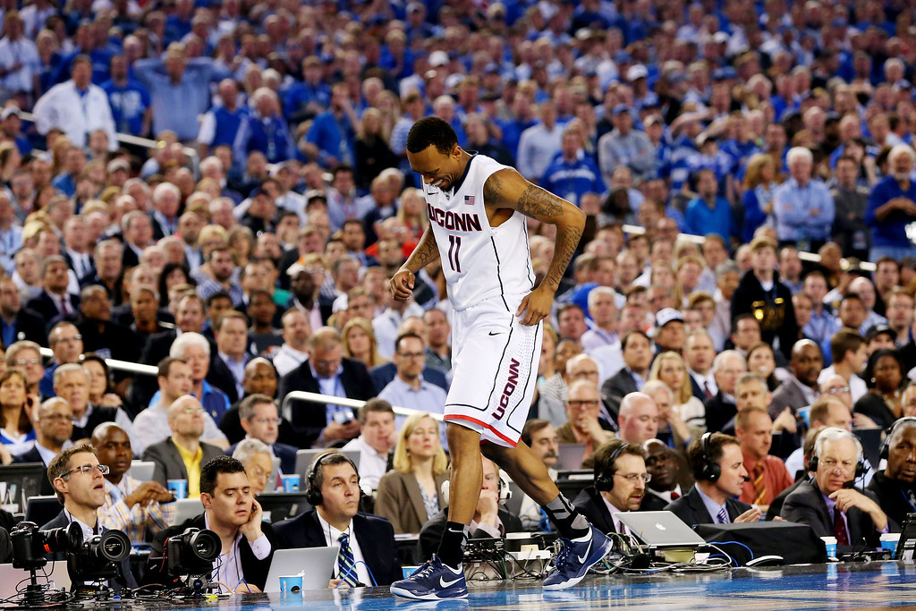 Description of . ARLINGTON, TX - APRIL 07:  Ryan Boatright #11 of the Connecticut Huskies reacts after hurting his ankle during the NCAA Men\'s Final Four Championship against the Kentucky Wildcats at AT&T Stadium on April 7, 2014 in Arlington, Texas.  (Photo by Ronald Martinez/Getty Images)