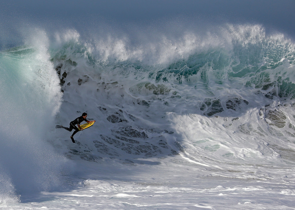 Description of . A bogieboarder rides a wave at the wedge in Newport Beach, Calif., Wednesday, Aug. 27, 2014. Southern California beachgoers experienced much higher than normal surf, brought on by Hurricane Marie spinning off the coast of Mexico. (AP Photo/Chris Carlson)