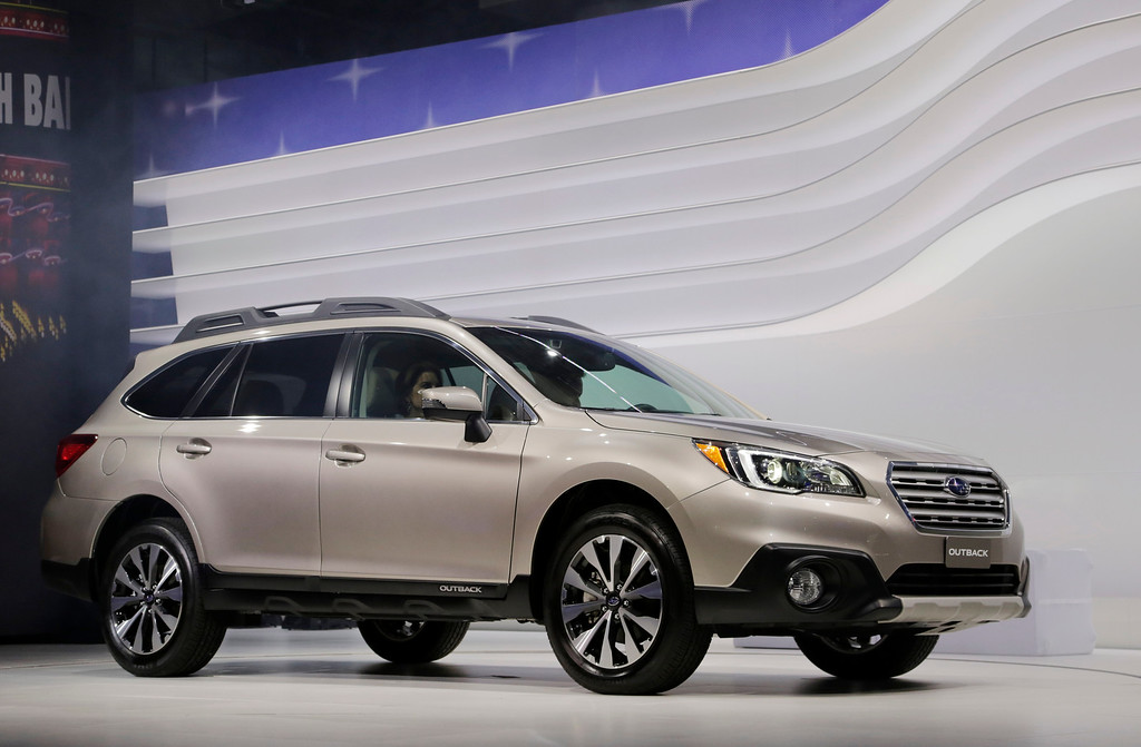 Description of . The 2015 Subaru Outback is shown at the New York International Auto Show, Thursday, April 17, 2014 in New York. (AP Photo/Mark Lennihan)