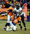 Denver Broncos quarterback Peyton Manning (18) gets sacked by Baltimore Ravens outside linebacker Terrell Suggs (55) during the fourth quarter.  The Denver Broncos vs Baltimore Ravens AFC Divisional playoff game at Sports Authority Field Saturday January 12, 2013. (Photo by Tim Rasmussen/The Denver Post)