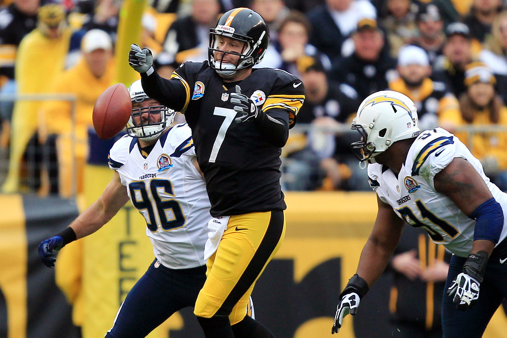 Description of . Pittsburgh Steelers quarterback Ben Roethlisberger (7) loses the ball as he passes under pressure by San Diego Chargers outside linebacker Jarret Johnson (96) and defensive end Kendall Reyes (91) in the first quarter of an NFL football game in Pittsburgh, Sunday, Dec. 9, 2012. (AP Photo/Gene J. Puskar)