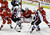 Detroit Red Wings center Cory Emmerton (25) and defenseman Jakub Kindl (4), of the Czech Republic, defend Colorado Avalanche right wing P.A. Parenteau (15) and center John Mitchell (7) in front of Detroit goalie Jimmy Howard (35) during the third period of an NHL hockey game in Detroit, Tuesday, March 5, 2013. Detroit won 2-1. (AP Photo/Carlos Osorio)