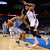 Denver Nuggets guard Andre Miller (L) is topped by the defense of Oklahoma City Thunder guard Thabo Sefolosha (R) in the first half of their NBA basketball game in Oklahoma City, Oklahoma January 16, 2013. REUTERS/Bill Waugh