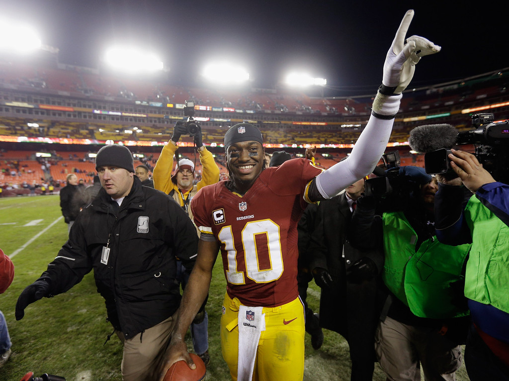 . LANDOVER, MD - DECEMBER 30: Quarterback Robert Griffin III #10 of the Washington Redskins celebrates after the Redskins defeated the Dallas Cowboys 28-18 at FedExField on December 30, 2012 in Landover, Maryland.  (Photo by Rob Carr/Getty Images)