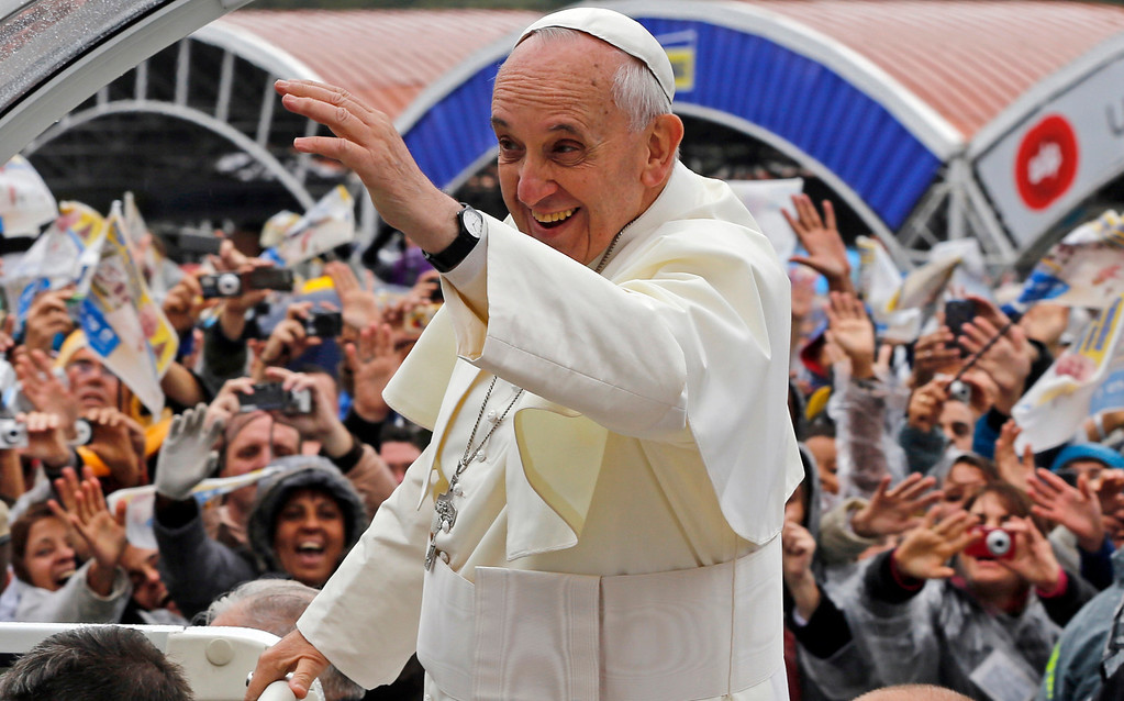 Description of . Pope Francis waves to pilgrims from his popemobile as he arrives to the Aparecida Basilica in Aparecida, Brazil, Wednesday, July 24, 2013. It was no coincidence that the first major event of his first foreign trip as pope was a Mass in Aparecida. The shrine, which draws 11 million pilgrims a year, hosted a critical 2007 meeting of Latin American bishops attended by then-Cardinal Jorge Mario Bergoglio. (AP Photo/Enric Marti)