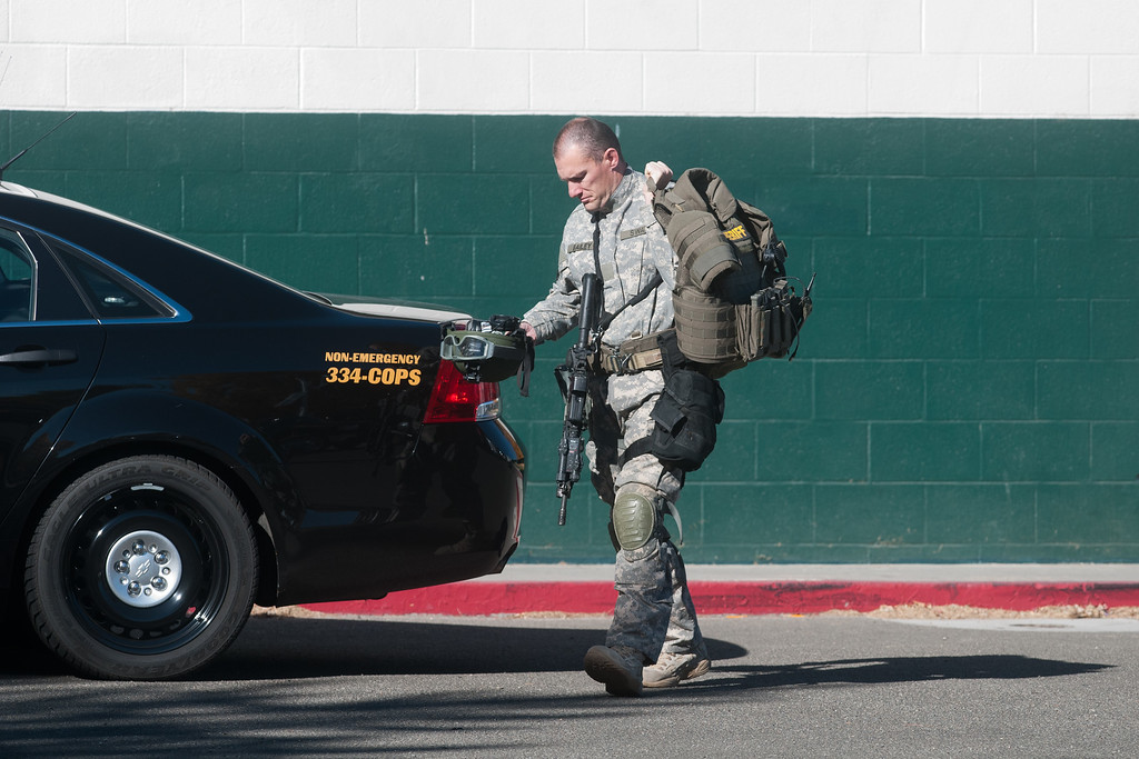 Description of . A police officer walks to his vehicle after a shooting at Sparks Middle School October 21, 2013 in Sparks, Nevada.  (Photo by David Calvert/Getty Images)