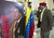 A man salutes a poster with a picture of the late Venezuelan President Hugo Chavez at Primada Cathedral, on March 8, 2013, in Bogota, during a religious ceremony on behalf of his soul. AFP PHOTO / Raul  ARBOLEDA/AFP/Getty Images