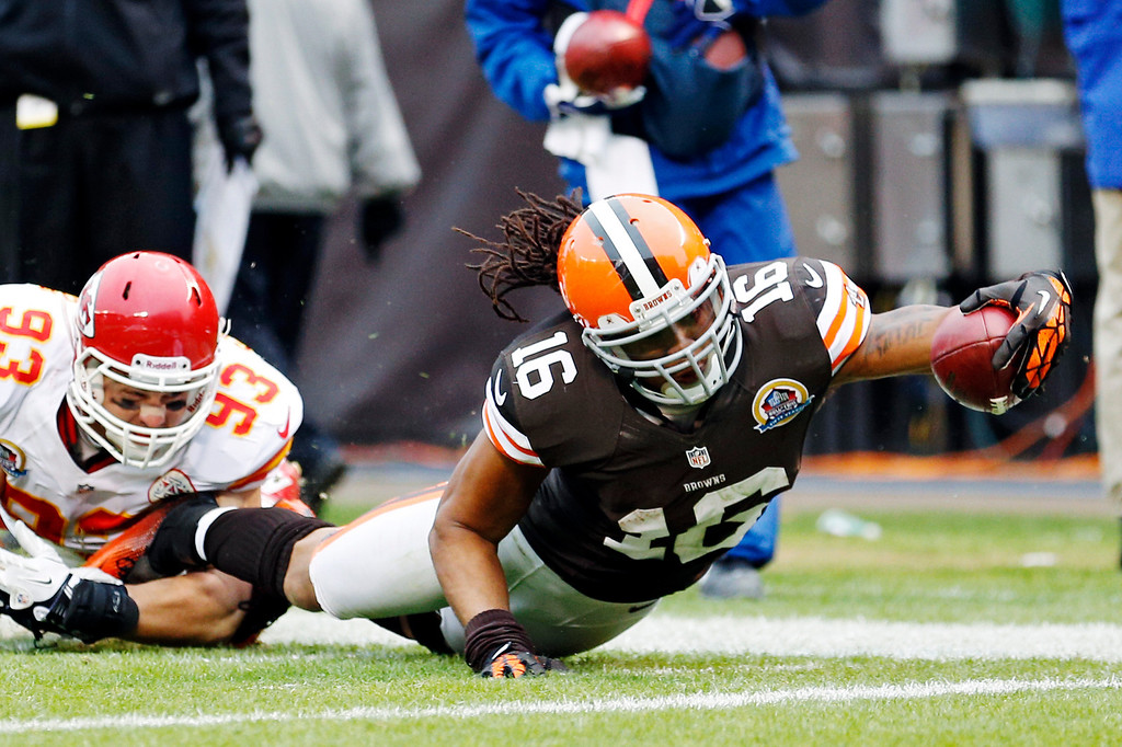. Cleveland Browns wide receiver Josh Cribbs (16) stretches for the goal line after being tackled by Kansas City Chiefs linebacker Cory Greenwood (93) in the third quarter of an NFL football game, Sunday, Dec. 9, 2012, in Cleveland. (AP Photo/Rick Osentoski)