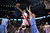 Toronto Raptors' DeMar DeRozan goes up for a dunk over Denver Nuggets' Tomofey Mozgov during the first half of an NBA basketball game in Toronto on Tuesday, Feb. 12, 2013. (AP Photo/The Canadian Press, Chris Young)