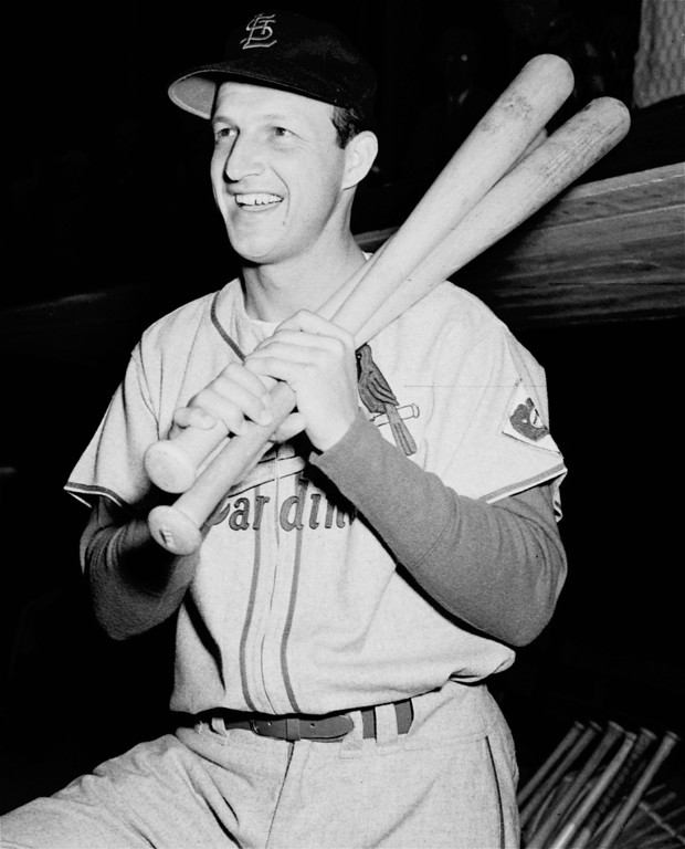 Description of . FILE - In this Feb. 25, 1952, file photo, St. Loius Cardinals; Stan Musial poses with his bats on his shoulder as he put on his St. Louis Cardinal uniform for the first time this season at spring training baseball in St. Petersburg, Fla. Musial, one of baseball's greatest hitters and a Hall of Famer with the St. Louis Cardinals for more than two decades, died Saturday, Jan 19, 2013, the Cardinals announced. He was 92. (AP Photo/Stroup, File)