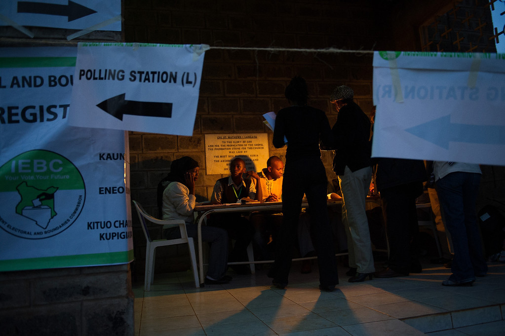 Description of . Staff from the Independent Electoral and Boundaries Commission (IEBC) prepare for the opening of a polling station in the Langata constituency of Nairobi, Kenya on March 4, 2013. Long lines of Kenyans queued from far before dawn to vote Monday in the first election since the violence racked polls five years ago, with a deadly police ambush hours before polling started marring the key ballot. The tense elections are seen as a crucial test for Kenya, with leaders vowing to avoid a repeat of the bloody 2007 to 2008 post poll violence in which over 1,100 people were killed, with observers repeatedly warning of the risk of renewed conflict.    PHIL MOORE/AFP/Getty Images