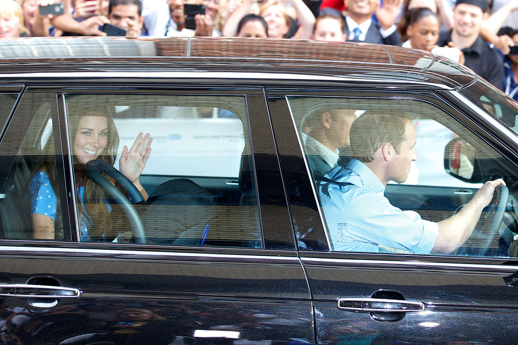 Description of . Catherine, Duchess of Cambridge (L) waves as she is driven by her husband, WIlliam, the Duke of Cambridge away from Lindo Wing of St Mary\'s Hospital in London on July 23, 2013. Her baby was born on Monday afternoon weighing eight pounds six ounces (3.8 kilogrammes). The baby is directly in line to inherit the throne after Charles, Queen Elizabeth II\'s eldest son and heir, and his eldest son William.  ANDREW COWIE/AFP/Getty Images