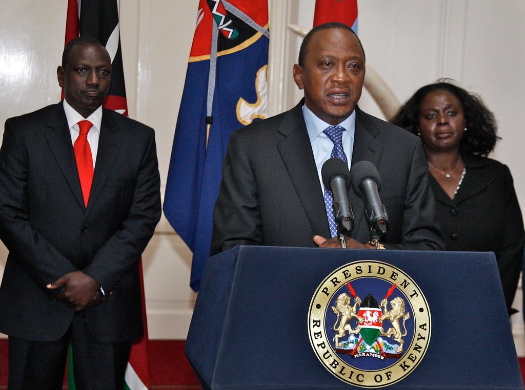 Description of . In this photo released by Kenya's Presidency, Kenyan President Uhuru Kenyatta, center, flanked by Deputy President William Ruto, left, and other senior Government and Security officials, makes a television address to the nation from State House in Nairobi, Kenya, Tuesday, Sept. 24, 2013. Kenyatta says security forces have finally defeated a small group of terrorists after four days of fighting at the Nairobi mall. (AP Photo/Kenya Presidency)