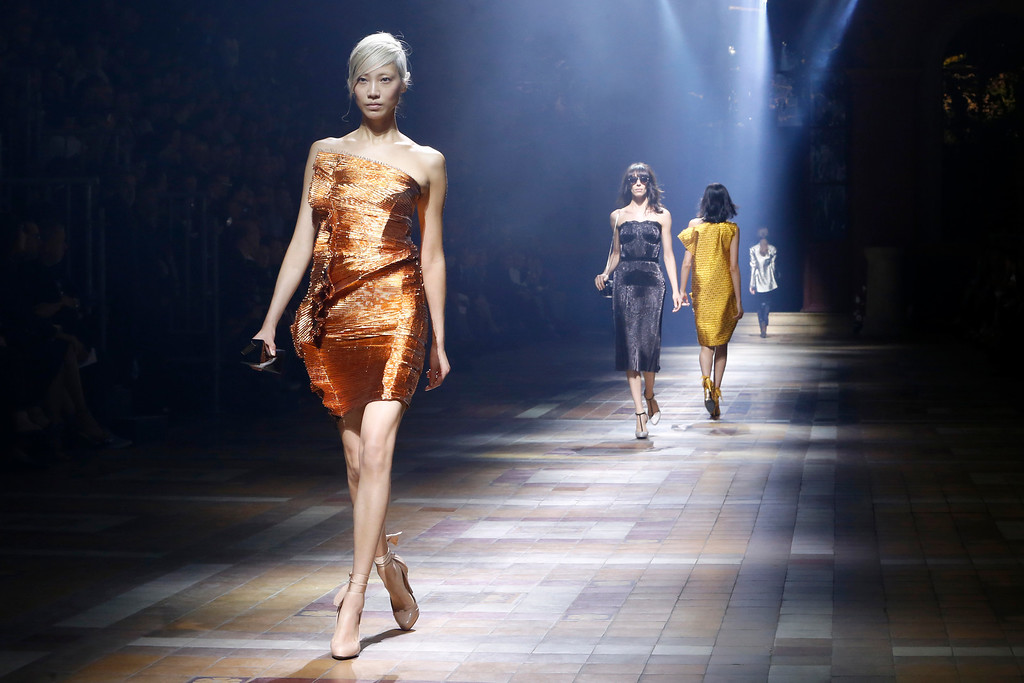 Description of . A model presents a creation as part of Lanvin's ready-to-wear Spring/Summer 2014 fashion collection, presented Thursday, Sept. 26, 2013 in Paris. (AP Photo/Jacques Brinon)